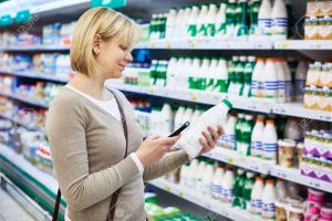 woman-choosing-dairy-products-grocery-store